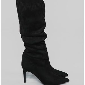 Knee high heeled boot